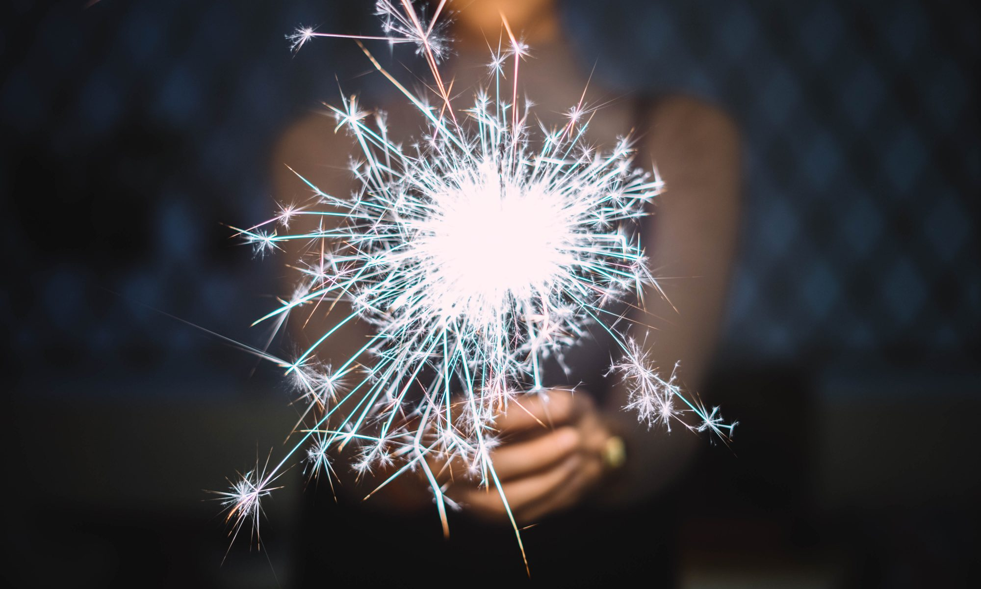 woman with firework sparklers